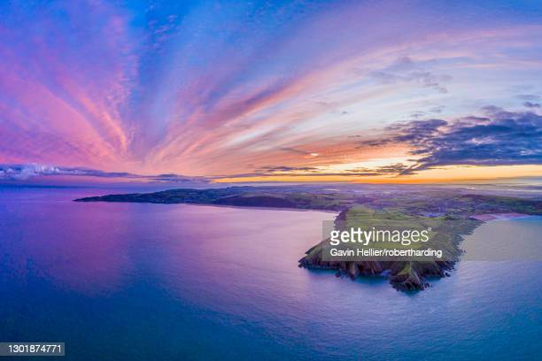 aerial sunrise view over baggy point towards woolacombe, morte bay, north devon, england, united kingdom, europe - gavin hellier stock pictures, royalty-free photos & images