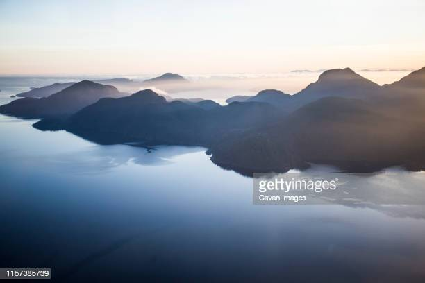 aerial sunset over coastline in british columbia - british columbia stock pictures, royalty-free photos & images
