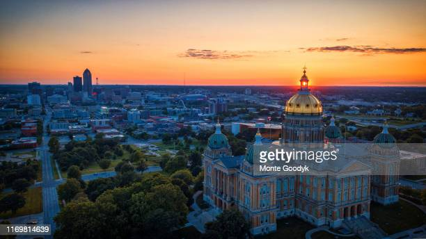 aerial sunset through the iowa capitol windows - des moines stock pictures, royalty-free photos & images