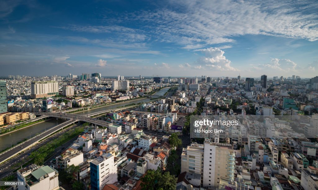 Aerial sunset view of houses and Business and Administrative Center of Ho Chi Minh city on NHIEU LOC canal : Stock Photo