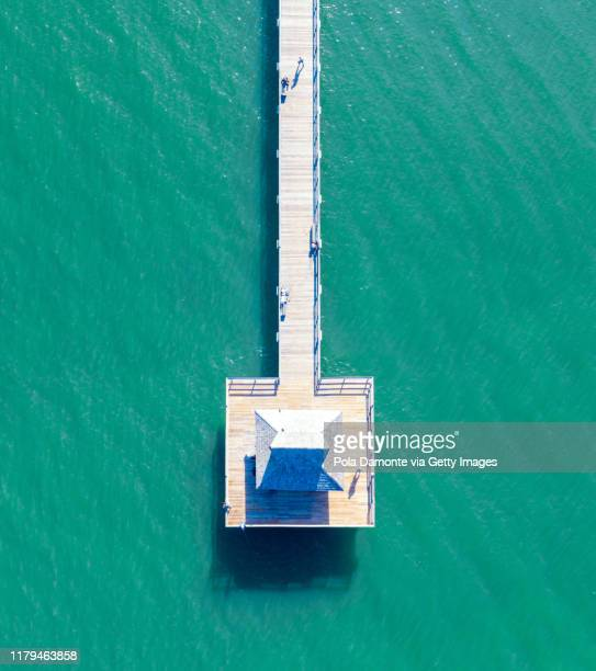aerial top point of view of naples pier and calm ocean, florida - naples florida stock pictures, royalty-free photos & images