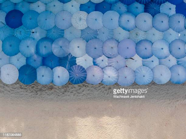 aerial top view, a large number of beautifully lined beach umbrellas on the beach. - travel stock pictures, royalty-free photos & images