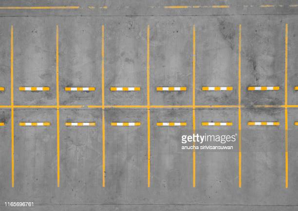 aerial top view car park road dividing line yellow without cars. - car park stock pictures, royalty-free photos & images