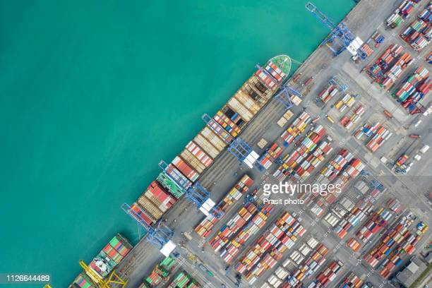 aerial top view container cargo ship working. business import export logistic and transportation of international by ship in the open sea. - pier stock pictures, royalty-free photos & images