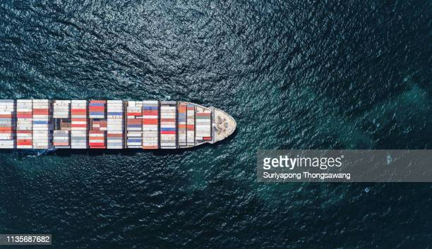 aerial top view container ship full load container on the deep sea for logistic, import export, shipping or transportation. - shipyard stock pictures, royalty-free photos & images