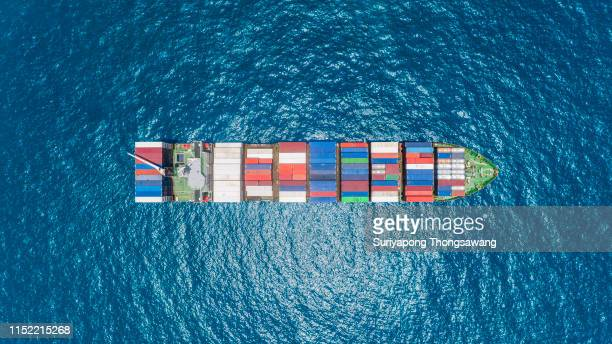 aerial top view container ship on the blue sea full load container for logistics, import export, shipping or transportation. - cargo ship stock pictures, royalty-free photos & images