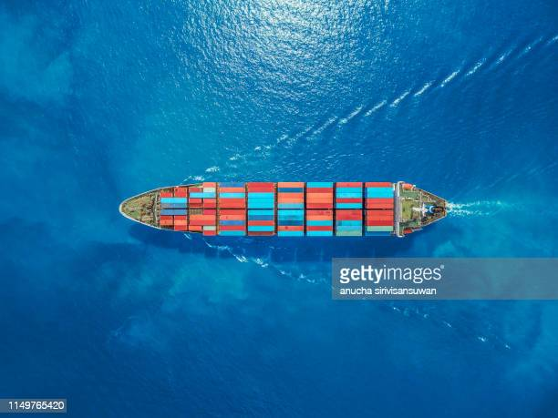 aerial top view container ship park for import export logistics in  pier, thailand. - transporte fotografías e imágenes de stock