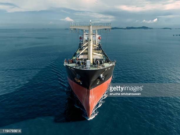 aerial top view container ship park for import export logistics in  pier, thailand. - warship stock pictures, royalty-free photos & images