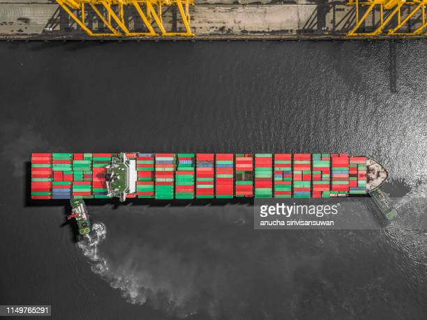 aerial top view container ship runing have wave in green sea, bangkok, thailand. - ship in a bottle stock pictures, royalty-free photos & images