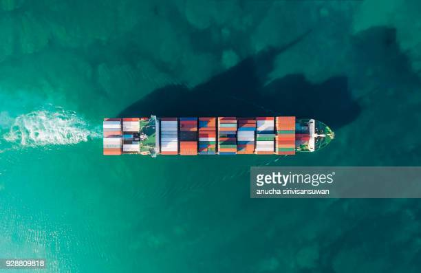 aerial top view container ship running shipping container in sea. - container stock pictures, royalty-free photos & images