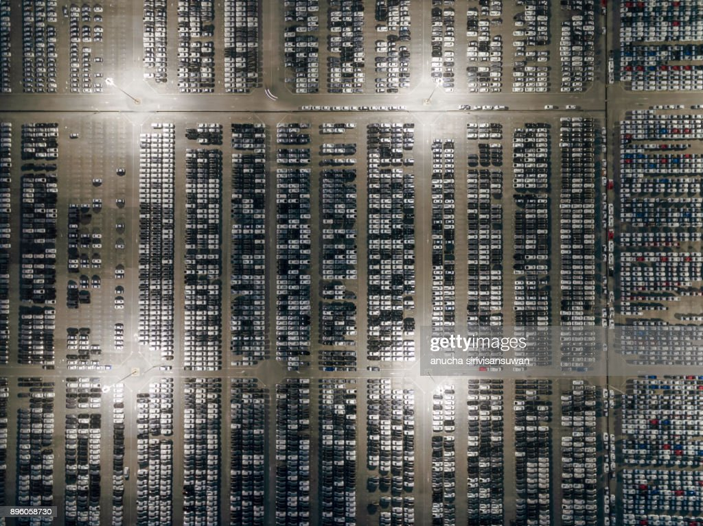 aerial top view factory car production to export at night. : Stock Photo