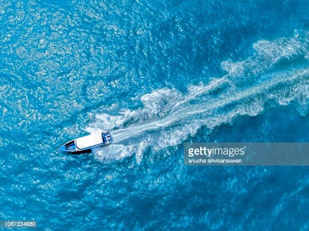 aerial top view luxury yacht sailing in sea . - top foto e immagini stock