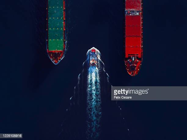 aerial top view marine traffic at the harbour. large transport shipping at the port. - schip watervaartuig stockfoto's en -beelden