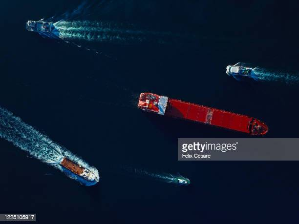 aerial top view marine traffic of a busy harbour. large transport shipping at the port. - sea life stock pictures, royalty-free photos & images
