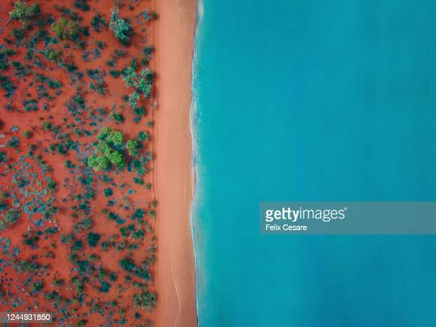 aerial top view of a bright orange sandy beach - australia stock pictures, royalty-free photos & images
