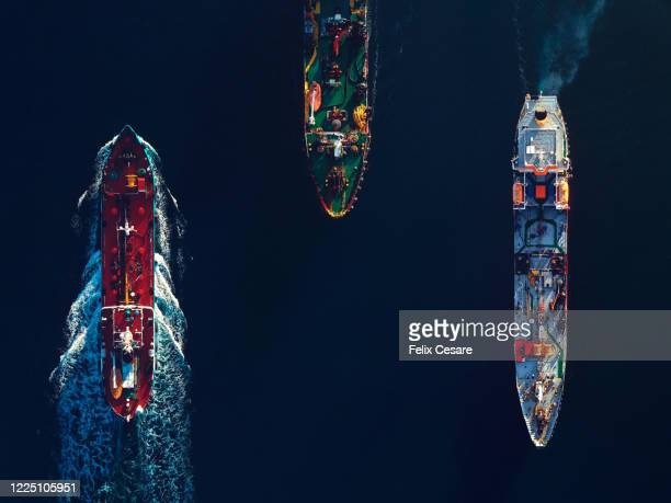 aerial top view of a busy harbour. large commercial ships cruising in the port - navigational equipment stock pictures, royalty-free photos & images