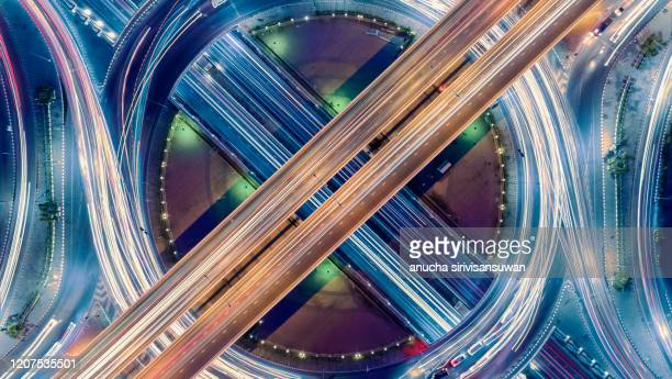 aerial top view of bangkok roundabout road at night, thailand. - car decoration stock pictures, royalty-free photos & images