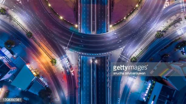 aerial top view of bangkok roundabout road at night, thailand. - ciudad fotografías e imágenes de stock
