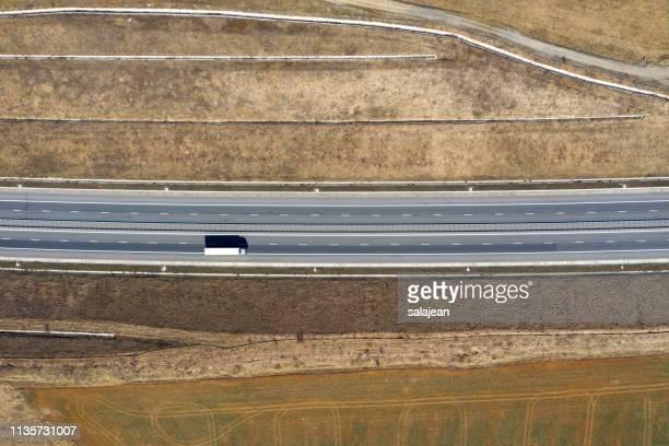 aerial top view cars trucks passing