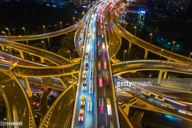 aerial top view of complicated multiple lane highway with traffic in day time - oakland california stock pictures, royalty-free photos & images
