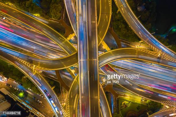 aerial top view of complicated multiple lane highway with traffic in day time - 高架道路 ストックフォトと画像