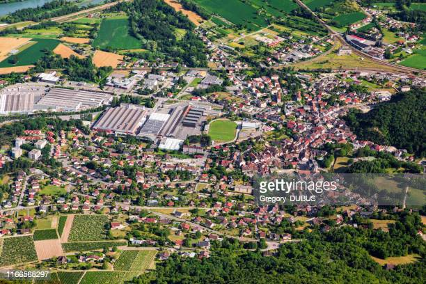 aerial top view of culoz small french town in ain department, auvergne-rhone-alpes region, with residential area and sports complex with football stadium in middle - auvergne rhône alpes stock pictures, royalty-free photos & images