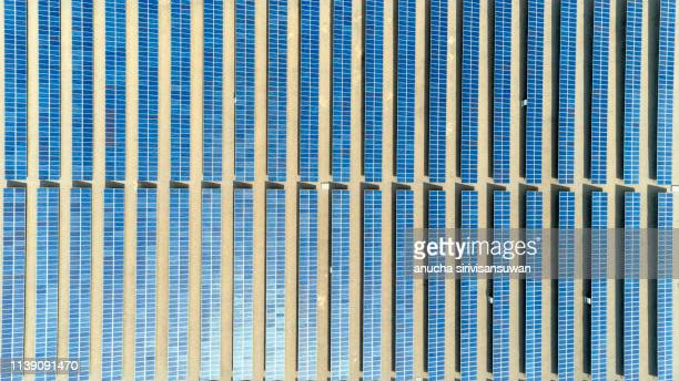 aerial top view of panel lined solar solar cell. - sustainable development goals stock pictures, royalty-free photos & images