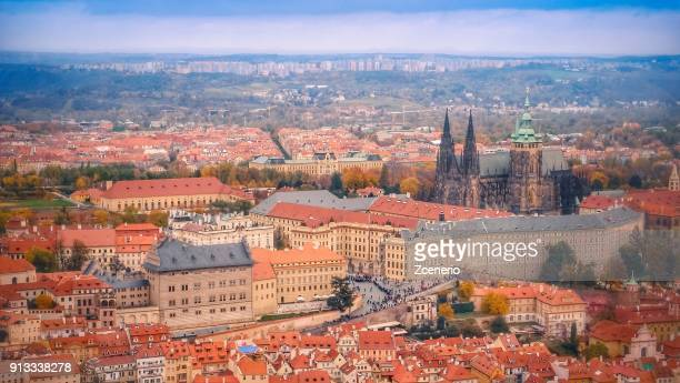 aerial top view of red roofs in the city of prague, czech republic from prague castle during autumn - hradcany castle stock pictures, royalty-free photos & images