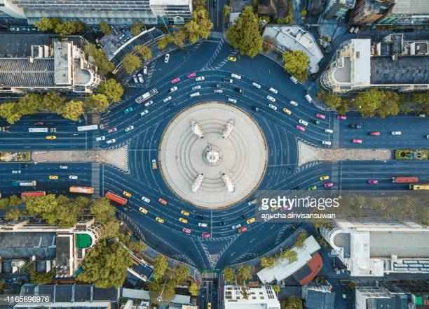 aerial top view of road intersection complex roundabout at day. - tree farm stock pictures, royalty-free photos & images