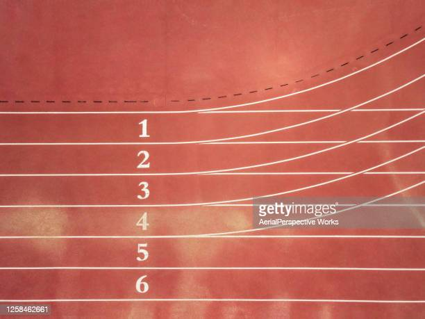 aerial top view of running track with numbers - sports track stock pictures, royalty-free photos & images