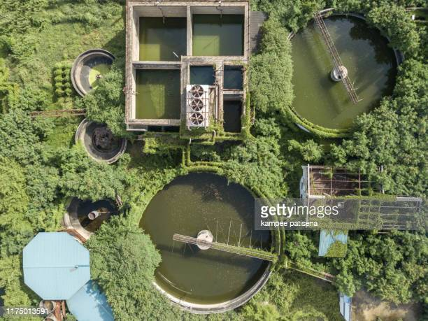 aerial top view of waste water treatment system in industrial estate - drain cleaner stock photos and pictures