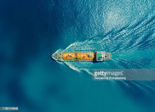 aerial top view oil or lpg ship tanker transportation oil/lpg from refinery on the blue sea. - ship stock pictures, royalty-free photos & images