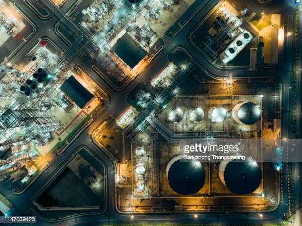 aerial top view oil refinery at night for energy industry or transportation background. - motor oil stock pictures, royalty-free photos & images