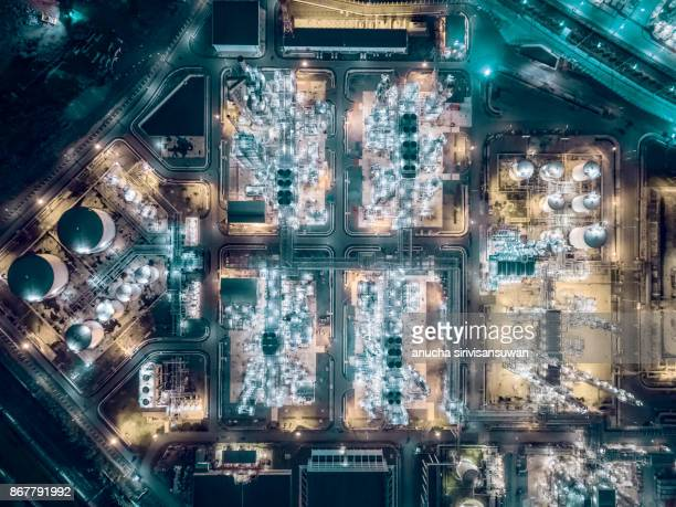 aerial top view Oil refinery at night .