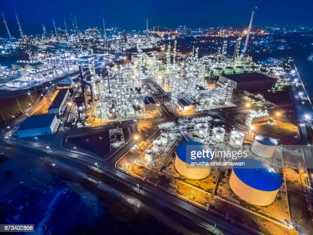 aerial top view oil refinery at night . - vaseline stock pictures, royalty-free photos & images