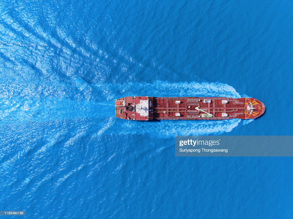 Aerial top view Oil ship tanker full speed with beautiful wave pattern transportation from refinery on the sea. : Stock Photo