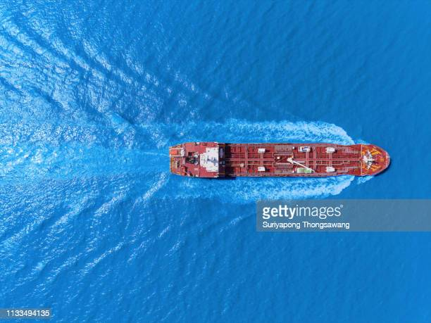 aerial top view oil ship tanker full speed with beautiful wave pattern transportation from refinery on the sea. - tanker - fotografias e filmes do acervo