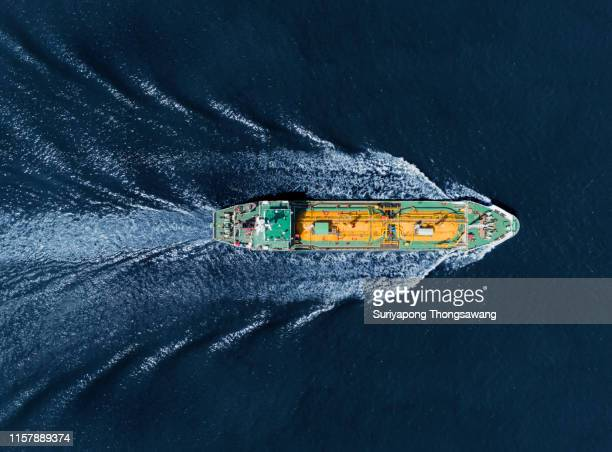 aerial top view oil ship tanker or liquefied petroleum gas (lpg) full speed for transportation oil from refinery on the deep sea. - motor oil stock pictures, royalty-free photos & images