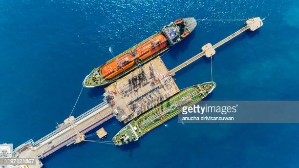 aerial top view oil tankers park at oil port. - 液化天然ガス ストックフォトと画像