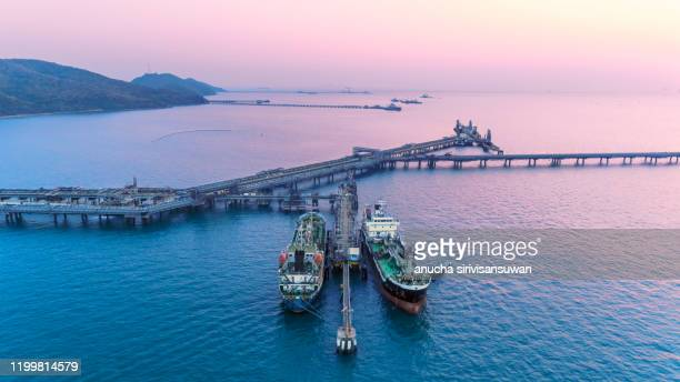 aerial top view oil tankers park at oil port. - indonesia logistics ストックフォトと画像