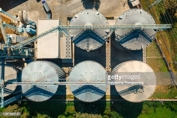 aerial top view rice or cereal plant silo for agriculture industry. - storage tank stock pictures, royalty-free photos & images