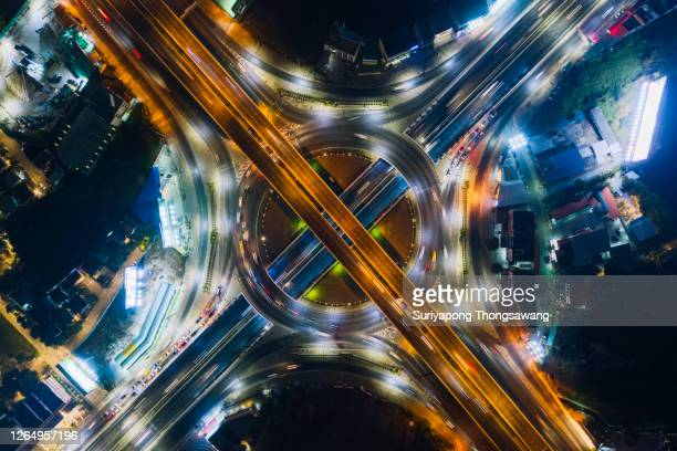 aerial top view road or connections bridge to the city at night for outdoors travel or transportation concept. - crossing stock pictures, royalty-free photos & images