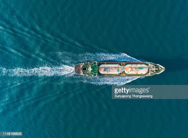 aerial top view ship tanker liquefied petroleum gas (lpg)  full speed with beautiful wave patter delivery energy from refinery. - motor oil stock pictures, royalty-free photos & images