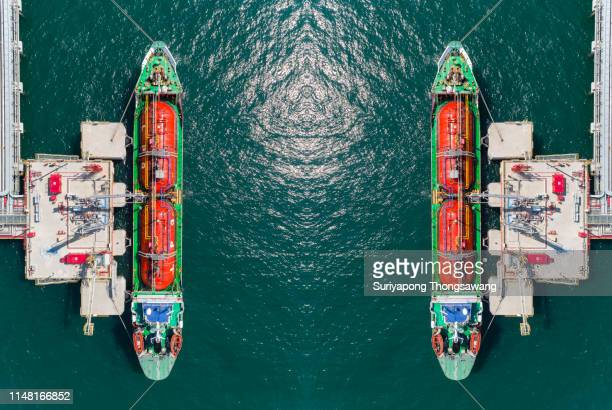 aerial top view ship tanker liquefied petroleum gas (lpg)  loading/unloading gas at bridge station from refinery for transportation. - motor oil stock pictures, royalty-free photos & images