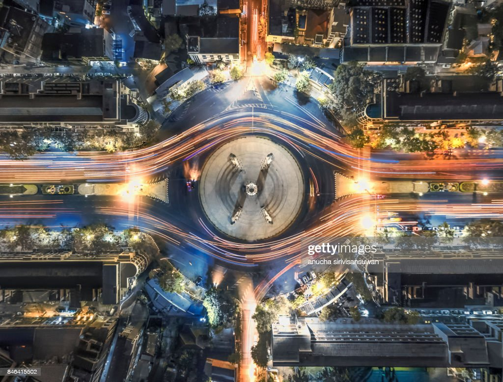 aerial top view traffic circle with speed light in city at night , Democracy Monument , bangkok , thailand . : Stock Photo