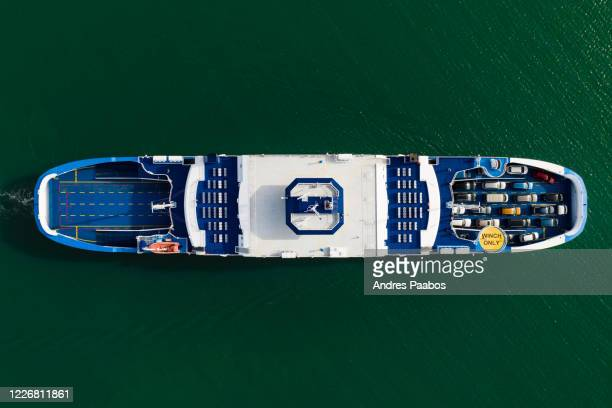 aerial top-down view of a passenger ferry, loaded with cars - estonia stock pictures, royalty-free photos & images