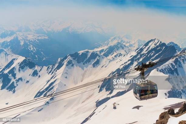 Aerial tramway and snowcovered mountains Pic du Midi de Bigorre HautesPyrenees department MidiPyrenees region France Europe