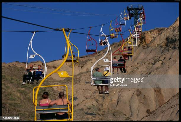 aerial tramway at alum bay cliffs - alum bay stock pictures, royalty-free photos & images