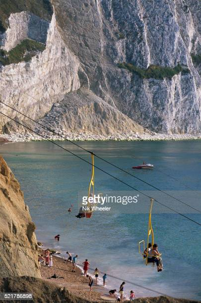 aerial tramway to beach at alum bay - alum bay stock pictures, royalty-free photos & images
