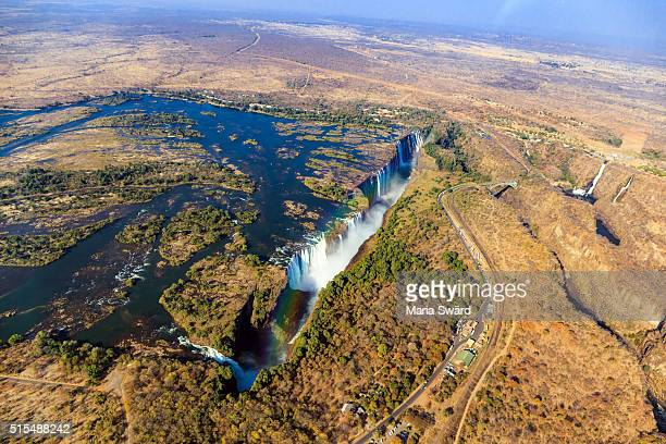 aerial victoria falls with rainbow, livingstone, zambia/zimbabwe - zimbabwe stock pictures, royalty-free photos & images